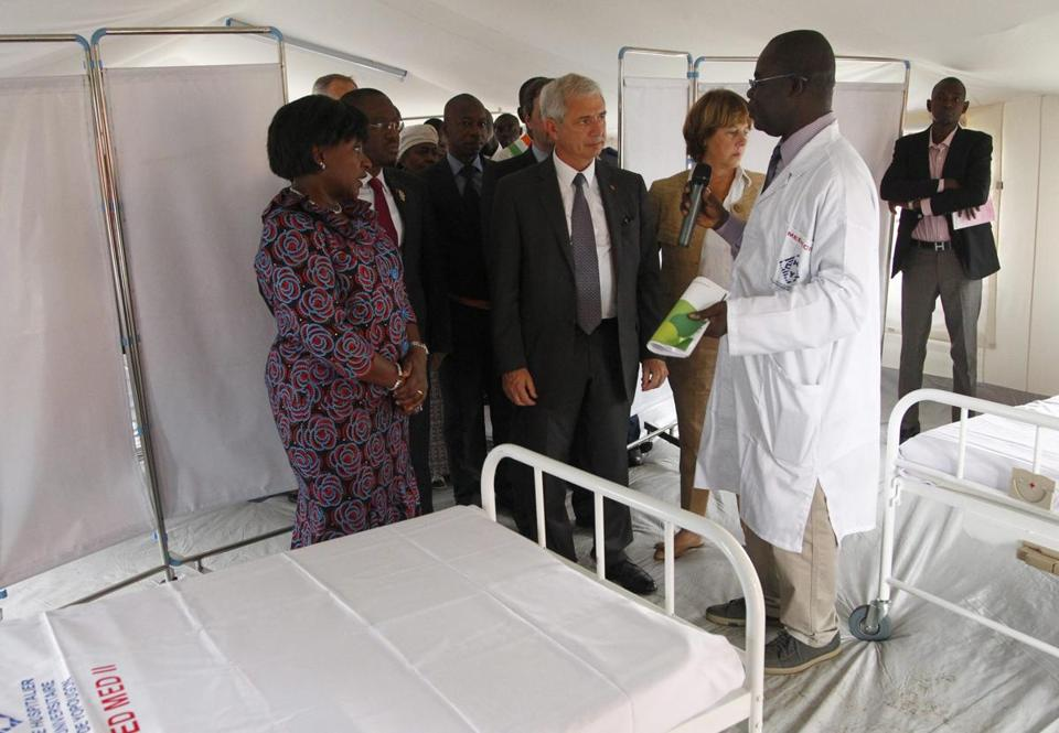 Ivory Coast's health minister, Raymonde Goudou (left), and a French official toured an Ebola unit Saturday in Yopougon.