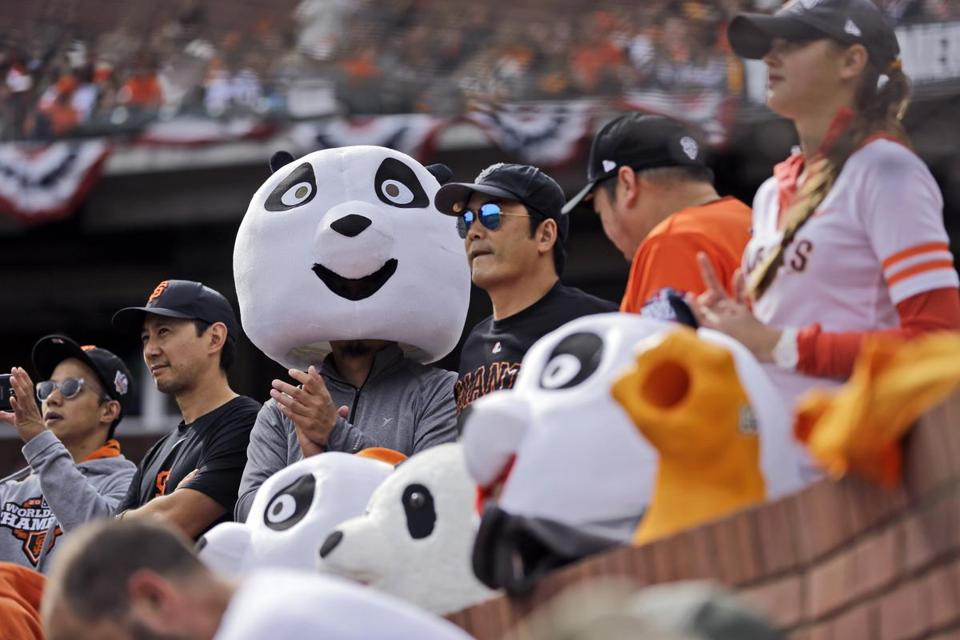 Fans wear panda heads for Giants third baseman Pablo Sandoval — the Kung Fu Panda — during Giants' home games. (AP Photo/Jeff Roberson)