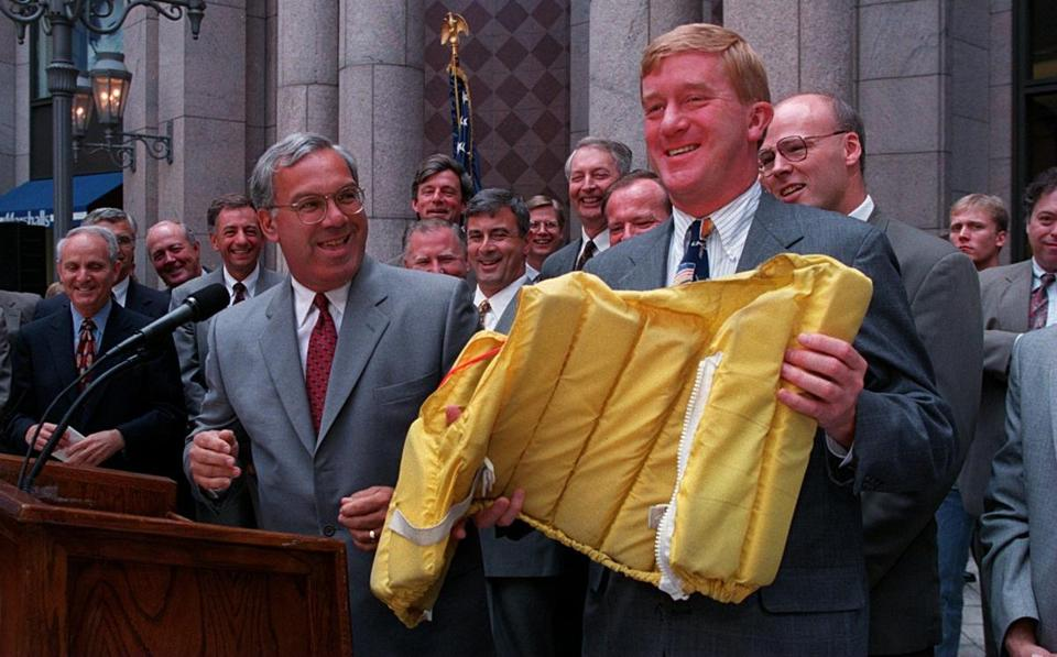 Boston Mayor Thomas M. Menino gave a life jacket to Weld before the Mutual Fund Tax Bill Cut signing in 1996.