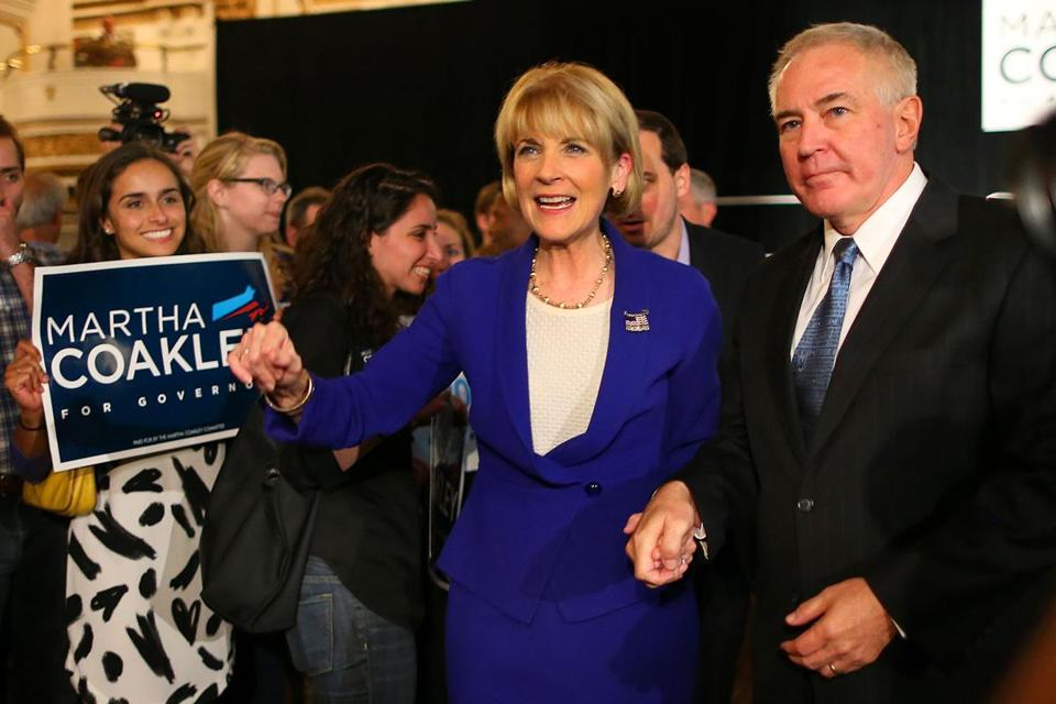 Thomas F. O'Connor Jr., shown with his wife, Martha Coakley, in Boston last month, is a constant presence at campaign events.