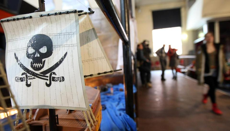 A Jolly Roger flag on a toy pirate ship at a meeting of the German Pirate Party.
