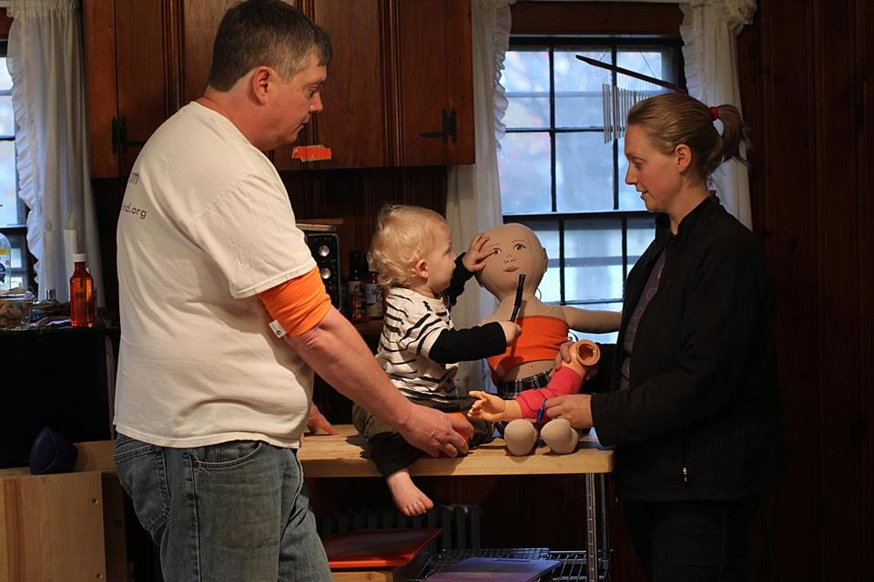 Mike and Kezia Fitzgerald, shown with their son, Lochlan, began making their medical device at their Danvers home.