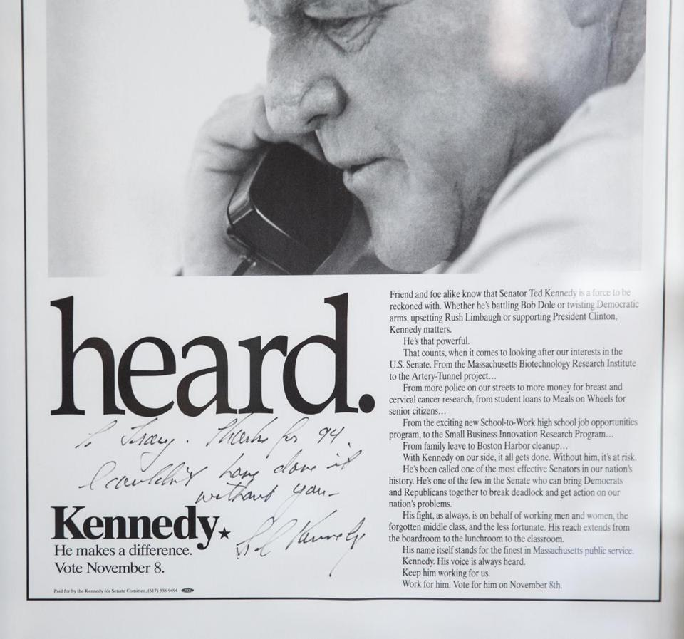 A newspaper advertisement with a personalized message from Ted Kennedy hangs in Tracy Spicer's office.