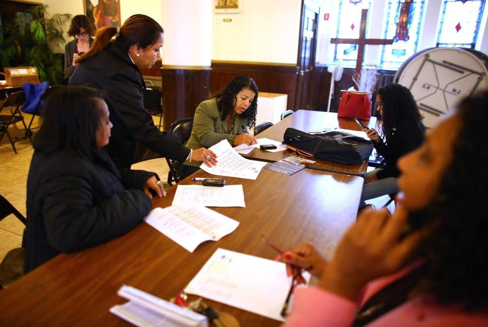 After the Cape Verdean Mass at St. Edith Stein Parish in Brockton, a phone bank was held to promote Question 4.