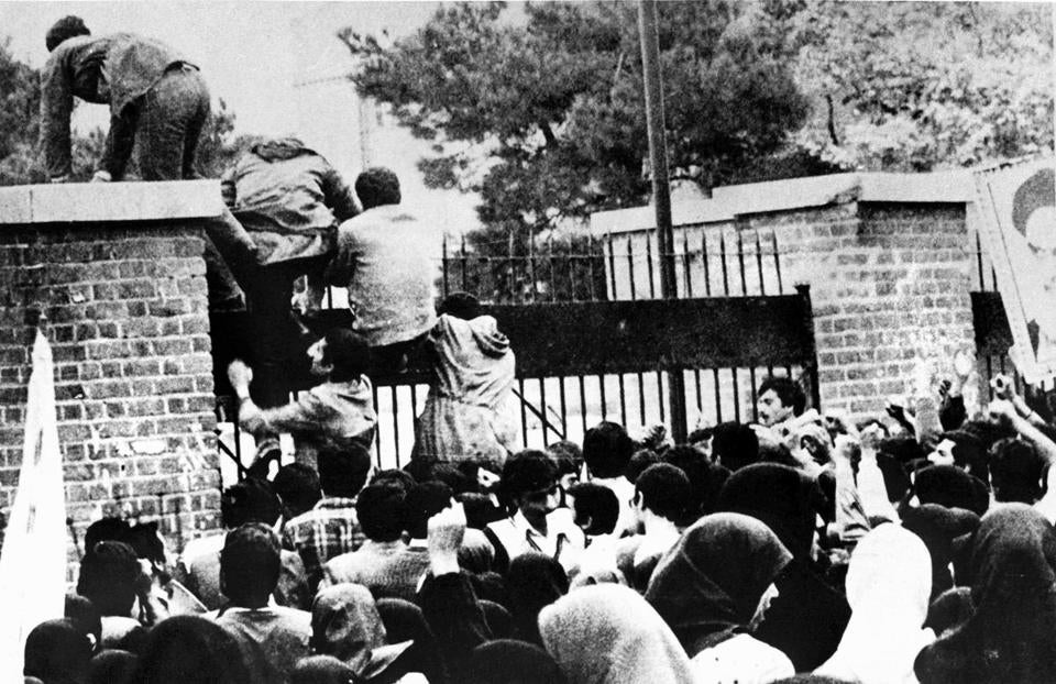 Iranian students climbed over the wall of the US embassy in Tehran on Nov. 4, 1979.