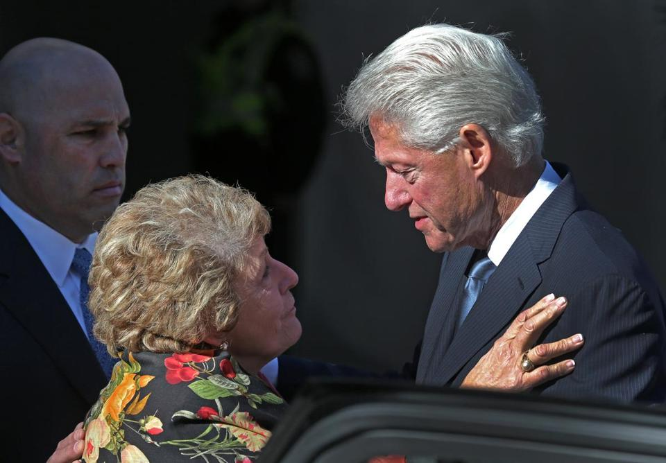 Thomas Menino Jr. and his mother, Angela, were consoled by former president Bill Clinton outside Faneuil Hall.