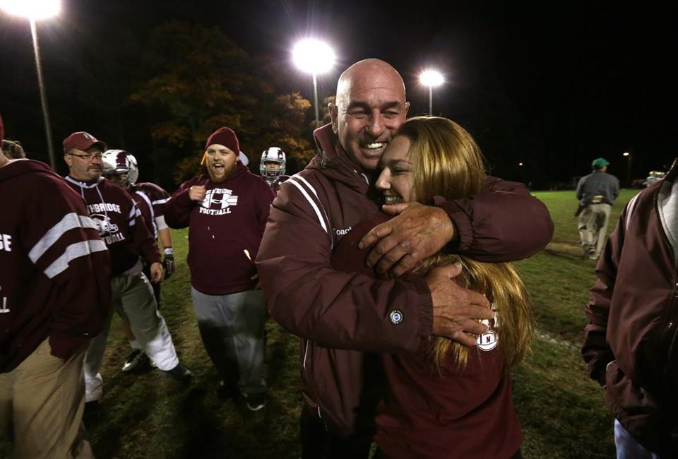 Whitinsville , MA - 10/31/14 - MAGAZINE SHOOT: Lachapelle receives a hug from a family member after the game. Story about Northbridge High School football head coach Ken Lachapelle. LaChapelle, who in his 39th year at the helm of Northbridge became the state's all-time winningest coach breaking the record at home for his 324th career win against visiting Clinton High School in the first round of the MIAA playoffs. - (Barry Chin/Globe Staff), Section: Magazine, Reporter: unknown, Topic: 111614football, LOID: 7.4.3204210885.