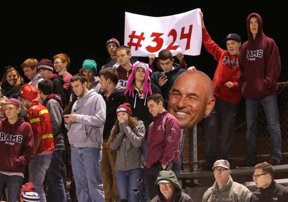 Whitinsville , MA - 10/31/14 - MAGAZINE SHOOT: Fans in the stands recognize Lachapelle's achievement. Story about Northbridge High School football head coach Ken Lachapelle. LaChapelle, who in his 39th year at the helm of Northbridge became the state's all-time winningest coach breaking the record at home for his 324th career win against visiting Clinton High School in the first round of the MIAA playoffs. - (Barry Chin/Globe Staff), Section: Magazine, Reporter: unknown, Topic: 111614football, LOID: 7.4.3204210885.