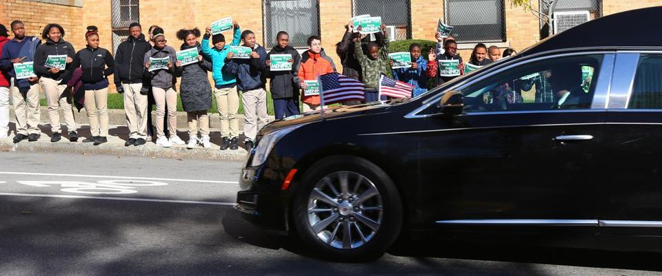 Students at the Roslindale campus of Brooke Charter Schools lined the sidewalk Nov. 3 as Mayor Thomas M. Menino's funeral procession passed by.