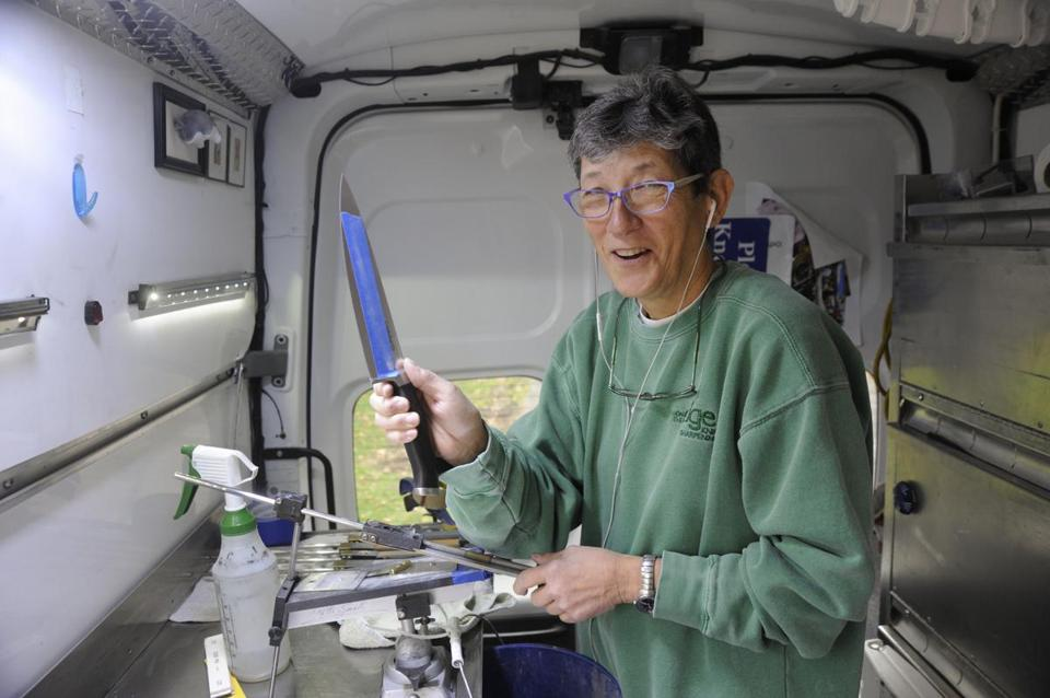 Patti Small at work in On the Edge Knife Sharpening's van.