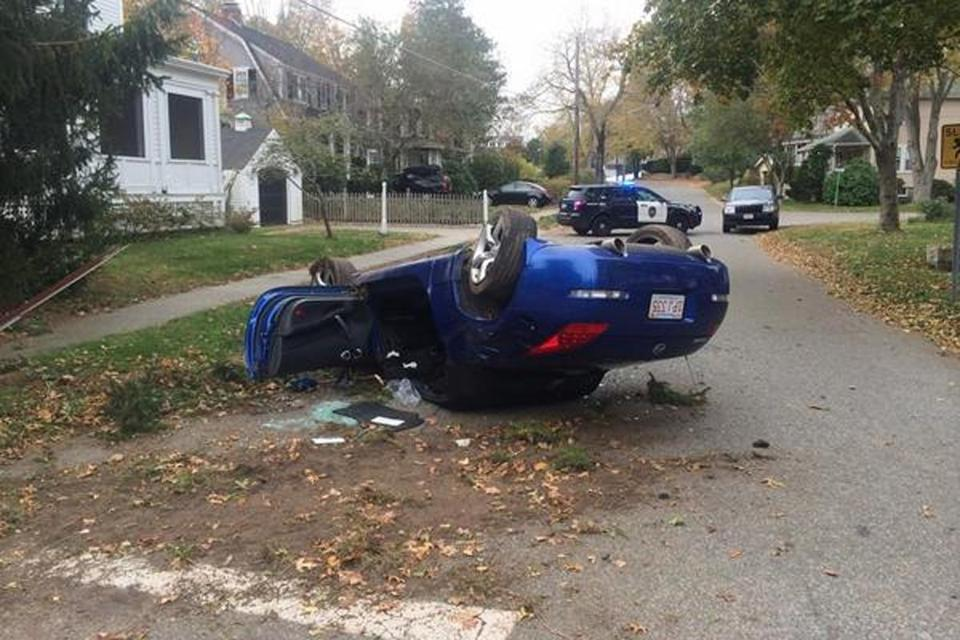 A picture tweeted by the Hingham Police Department shows a car overturned on Central and Emerald streets.