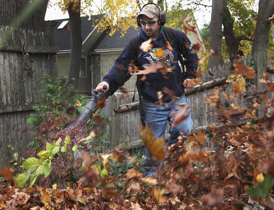 Waltham landscaper Michael Dooling, a Plowz & Mowz provider, cleared leaves from a Newton yard.