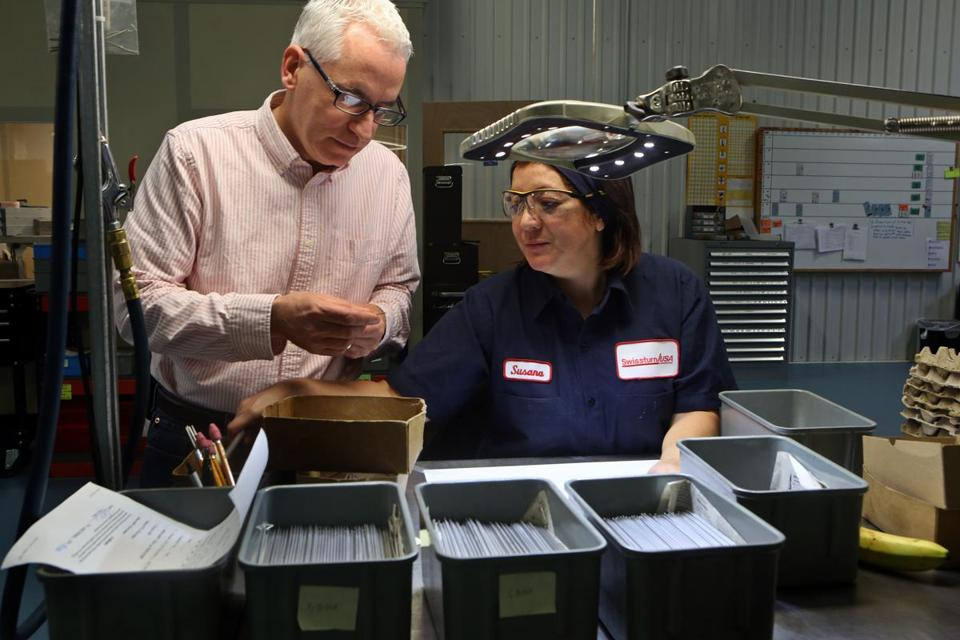 """What's important is we create a favorable environment by removing barriers,"" said Kenneth Mandile (pictured, with Susana Roman at his machine shop.)"