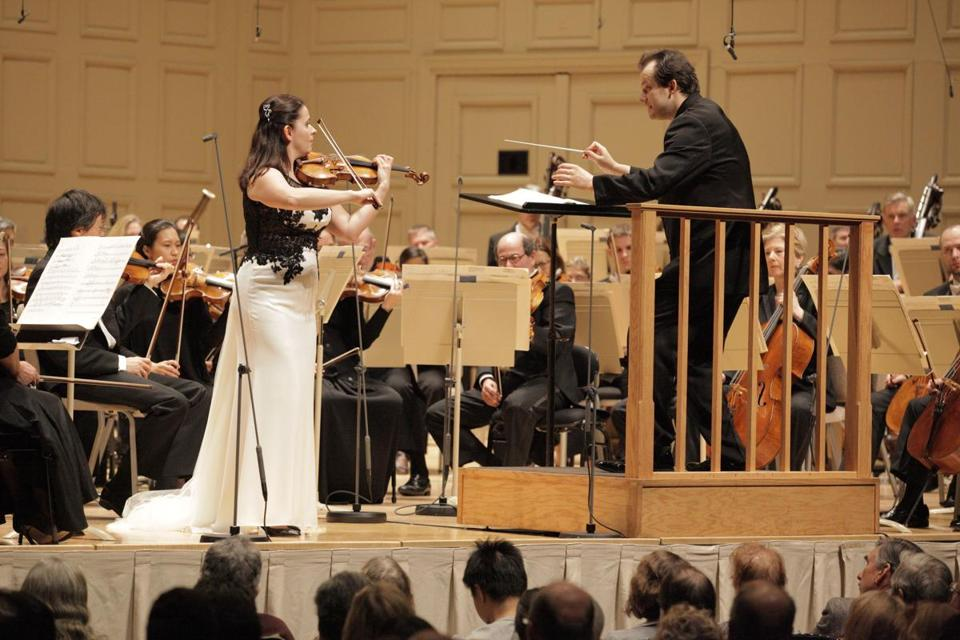Violinist Baiba Skride and conductor Andris Nelsons performing with the Boston Symphony Orchestra on Thursday night.