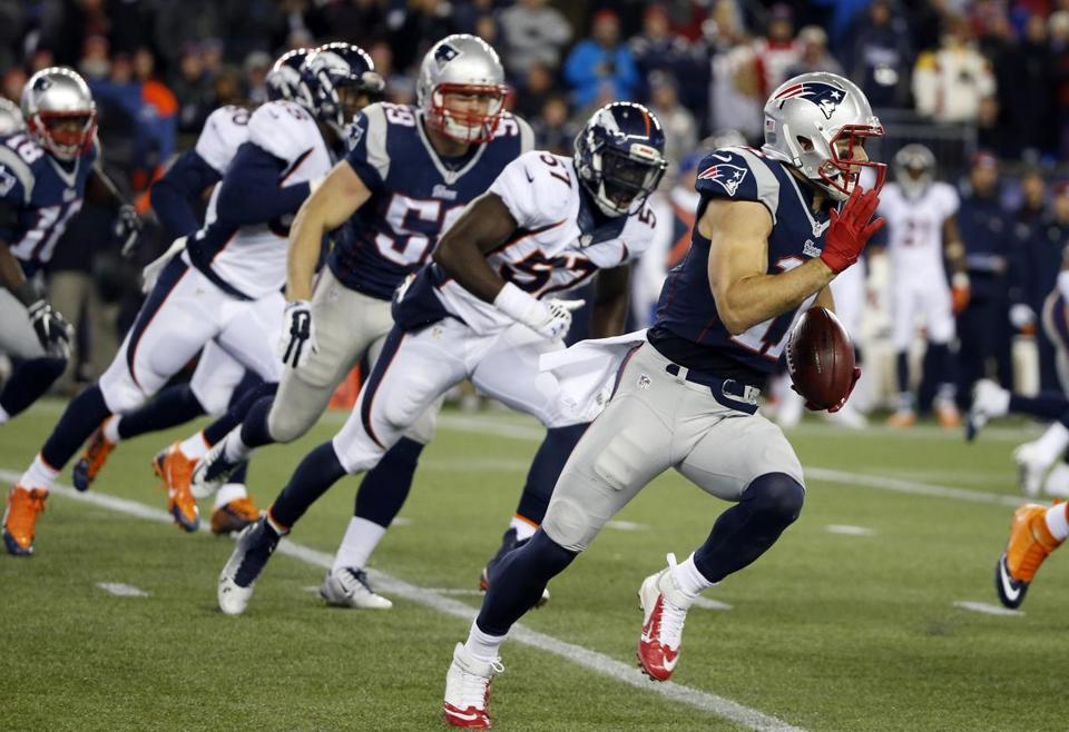 Julian Edelman returned a punt for an 84-yard touchdown against the Denver Broncos on Sunday.