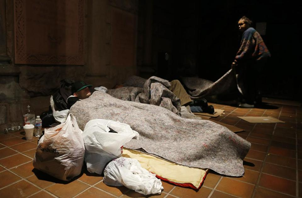 Kayla Nauti (left) and Susan Bakerjones slept at Trinity Church in Boston early last month. Jessica Rinaldi/Globe Staff