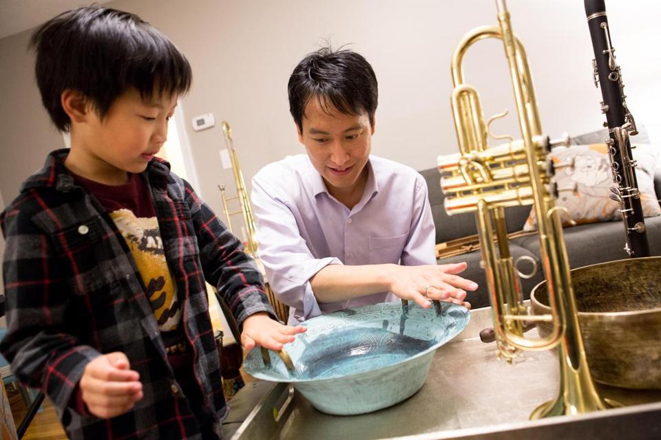 Anwell Tsai and his son, Alec, 6, played a Chinese spouting bowl. Alex helps Tsai test new techniques for his Playful Tunes music instruction program for children.