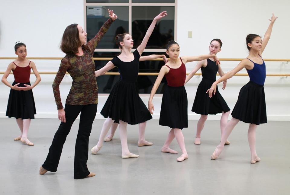 "Melanie Atkins, Children's Ballet Mistress for Boston Ballet, working with young dancers at a rehearsal for ""The Nut-cracker."""