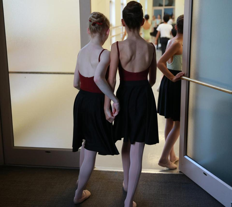 "Boston Ma. 10/08/2014 Young dancer's head back into a rehearsal with Melanie Atkins (cq) Children's Boston Ballet Mistress. She was working with young dancers at a rehearsal for the upcoming"" Nutcracker"" .Globe Staff/Photographer Jonathan Wiggs Topic: Reporter"