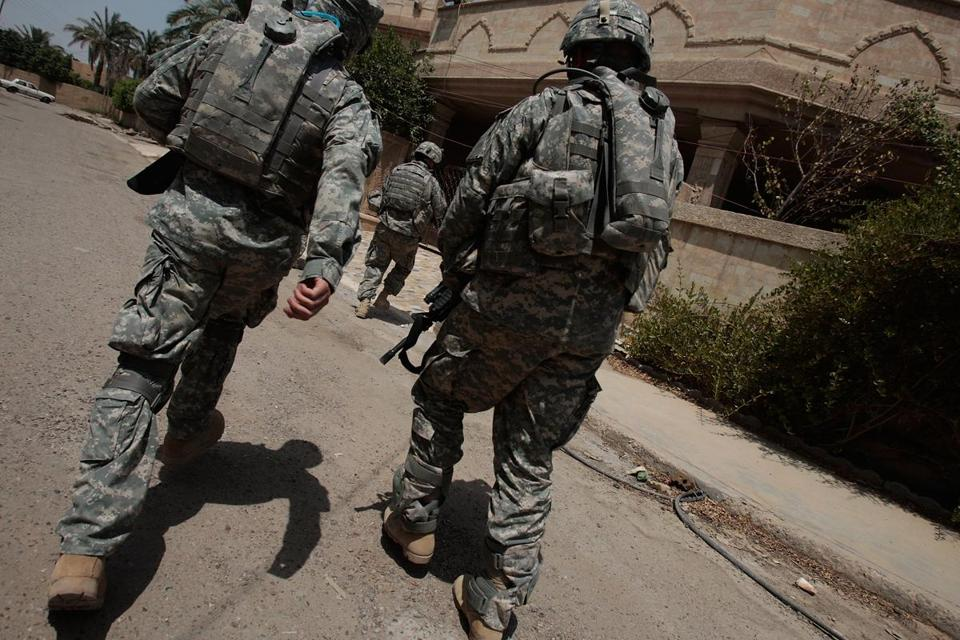 US soldiers warily approached a building in the tense Dora neighborhood of Baghdad in 2007.