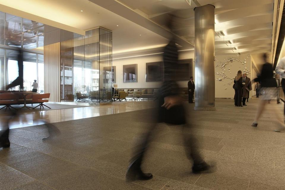 Abigail Johnson moved Fidelity's headquarters from staid Devonshire Street to the edge of the Seaport district at 245 Summer St. (lobby above).