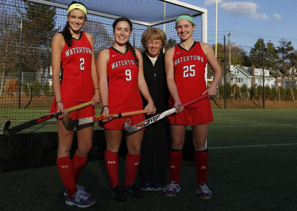 Watertown field hockey All-Scholastics Allie Doggett, Emily Loprete, coach Eileen Campbell, and Rachel Campbell.