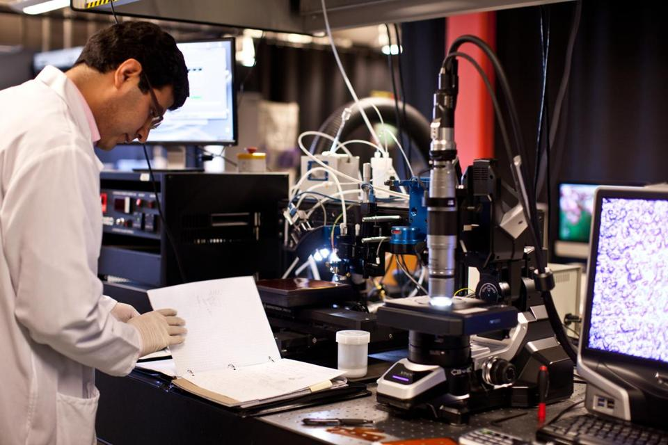 Mahdi Haghzadeh operated an aerosol jet printer used to print flexible electronics last month at UMass Lowell's Center for Photonics, Electromagnetics, and Nanoelectronics.