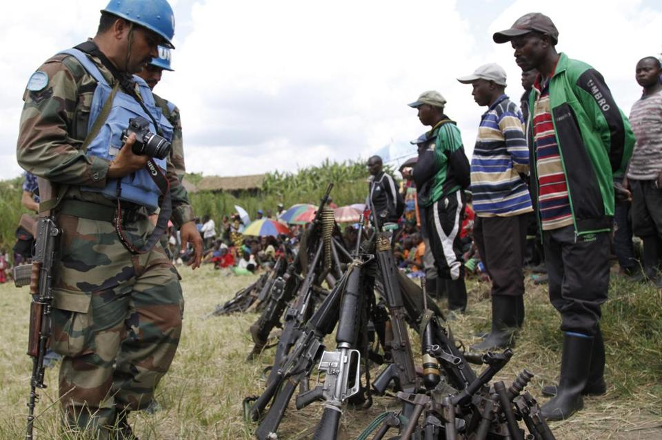 UN peacekeepers with weapons recovered from militants in Congo in May.