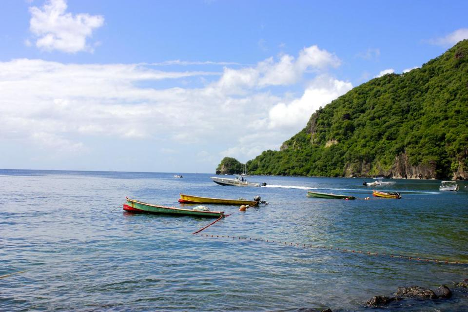 Boats sitting off the coast in Soufrire, St. Lucia.