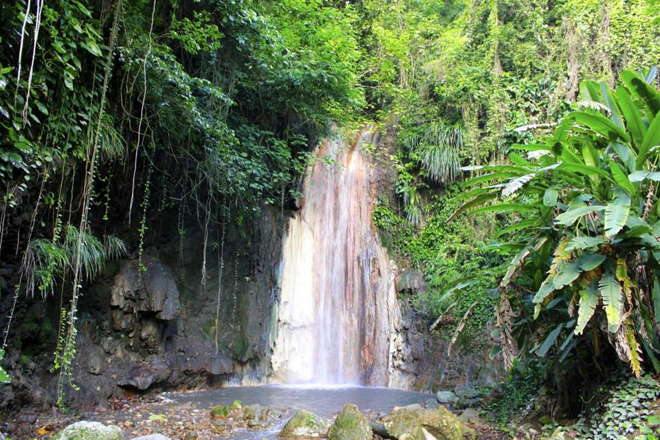 The waterfall at Diamond Falls Botanical Gardens in Soufriere, St. Lucia.
