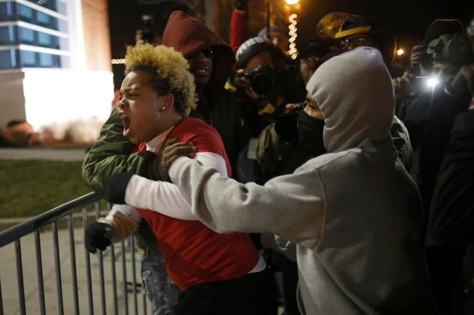 A woman approached the barricade to confront officers outside the Ferguson Police Department.