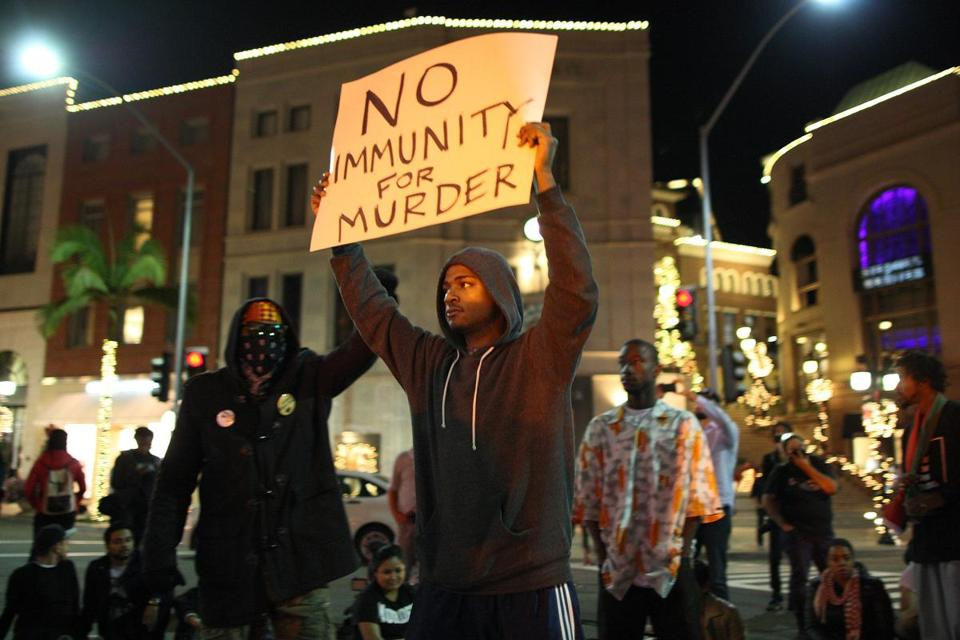 Protesters shut down traffic in Beverly HIlls while marching in reaction to the grand jury's decision not to indict Ferguson Police Officer Darren Wilson.