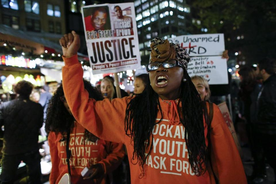 Demonstrators marched in New York Monday night in anticipation of the announcement of the grand jury's decision.