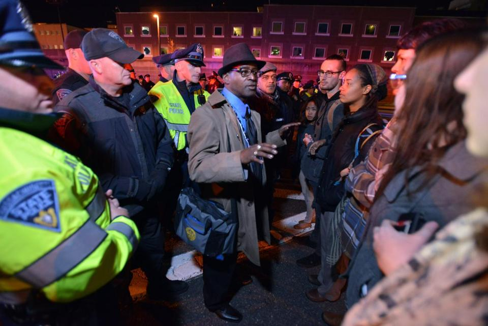 Supreme Richardson, an official with the Boston NAACP, spoke with protesters.