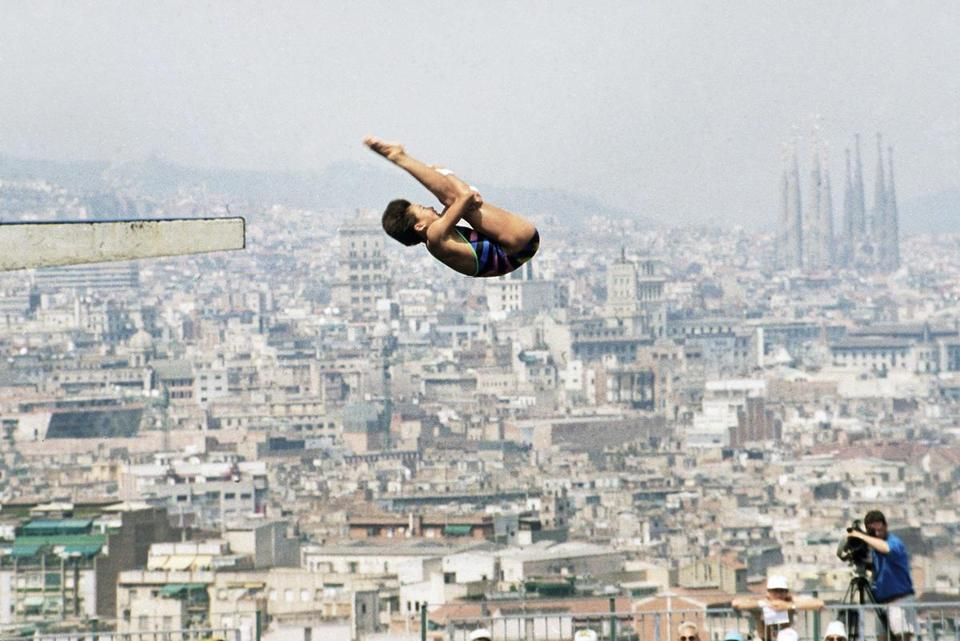 China's Fu Mingxia competed in a preliminary round in women's 10 meter Platform Diving during the 1992 Games. Barcelona's Sagrada Familia can be seen in the background.