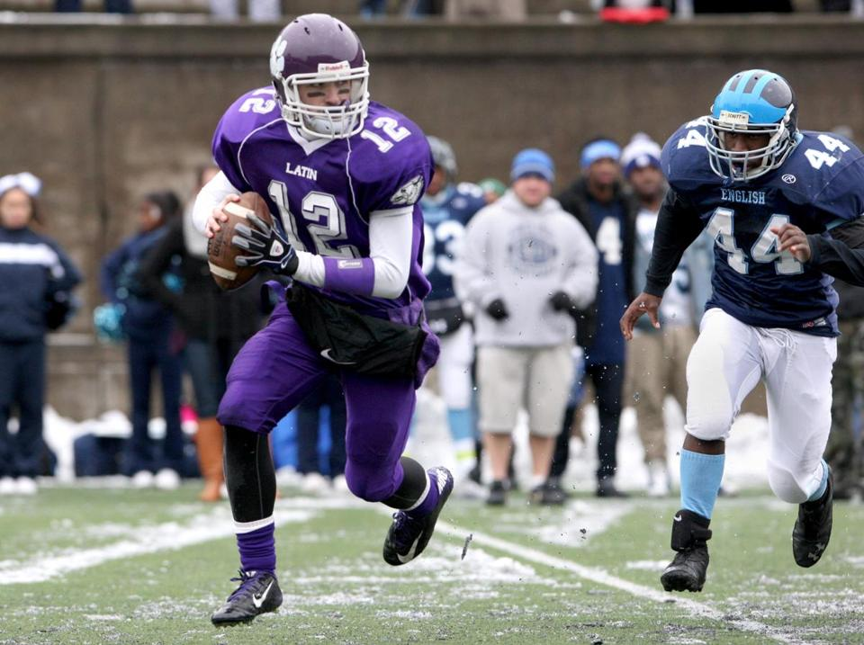 Boston Latin School quarterback Conor Freeley (12) threw for 158 yards and three touchdowns against Boston English.