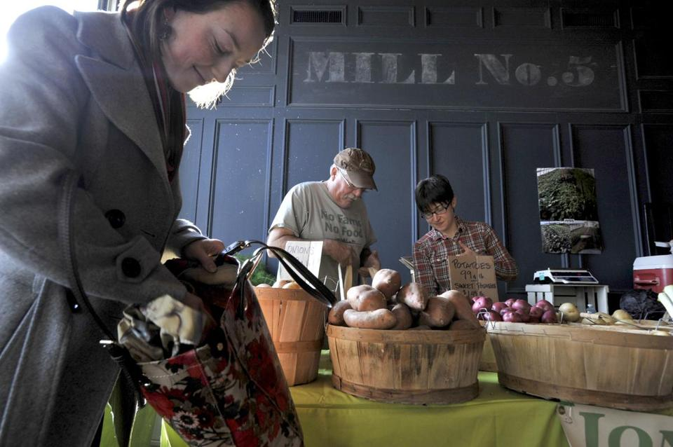 Christina Rohrbacher bought potatoes from Chelmsford growers Phil Jones and Ashley Sacramo of Jones Farm at Mill No. 5.