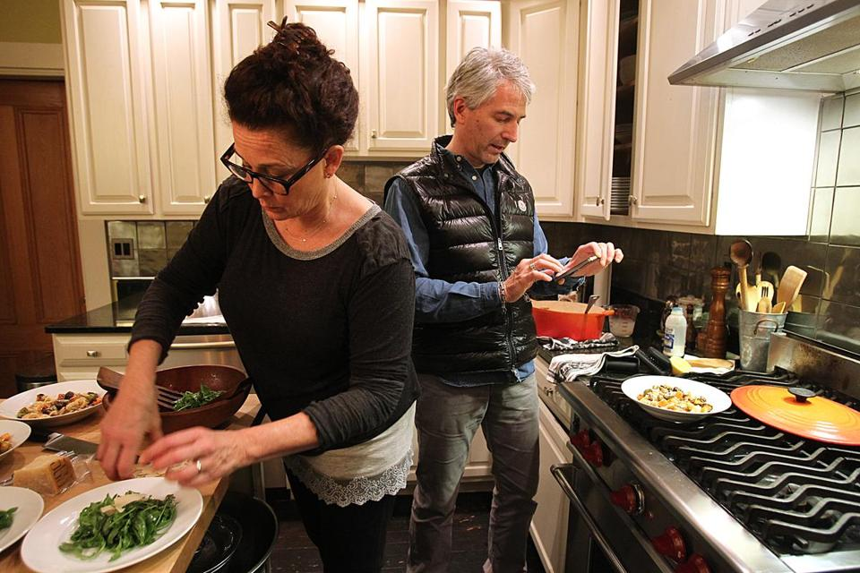 Instagram aficionados Linda and Jonathan Plazonja making dinner — and photographing it — in their Brookline kitchen.