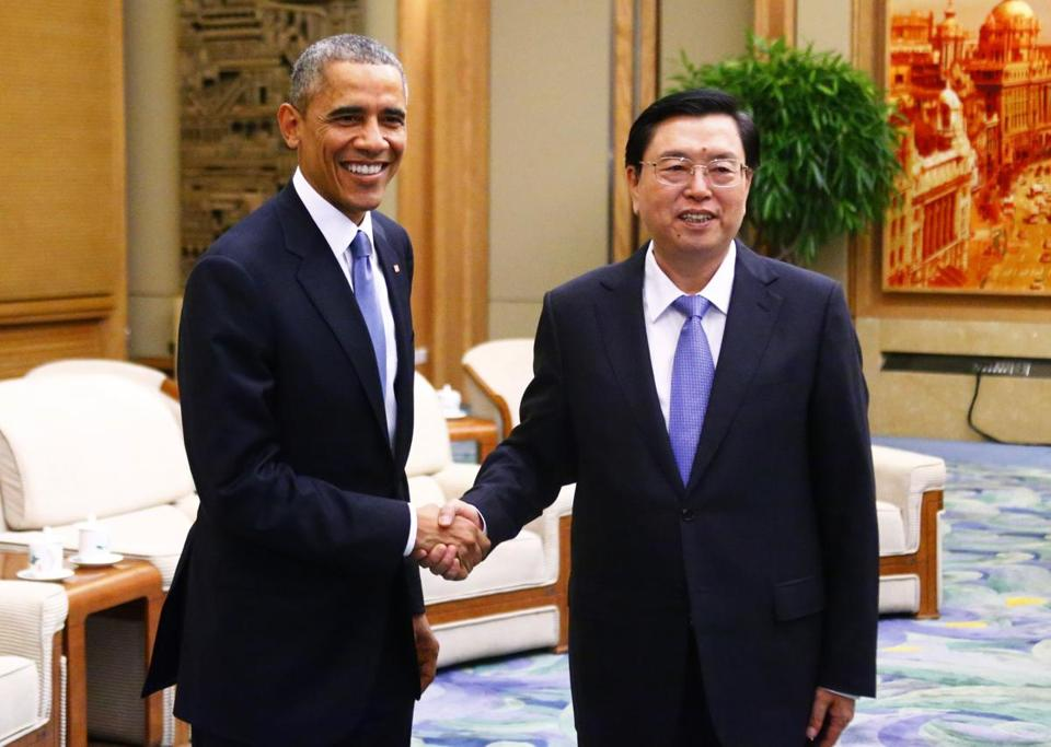 President Obama shook hands with Zhang Dejiang, Chairman of the Standing Committee of the National People's Congress, during a meeting in Beijing.