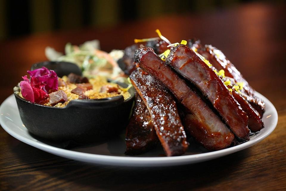 Pork ribs are served with homemade Tasso ham mac 'n cheese and Napa cabbage slaw at C.K. Pearl in Essex.