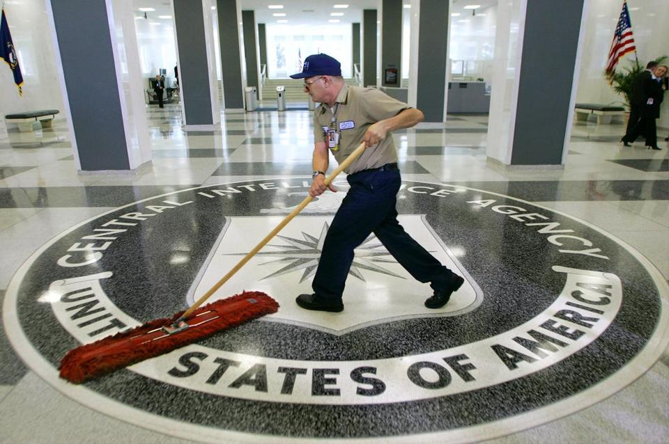 A workman slid a dustmop over the floor of CIA headquarters in Virginia.