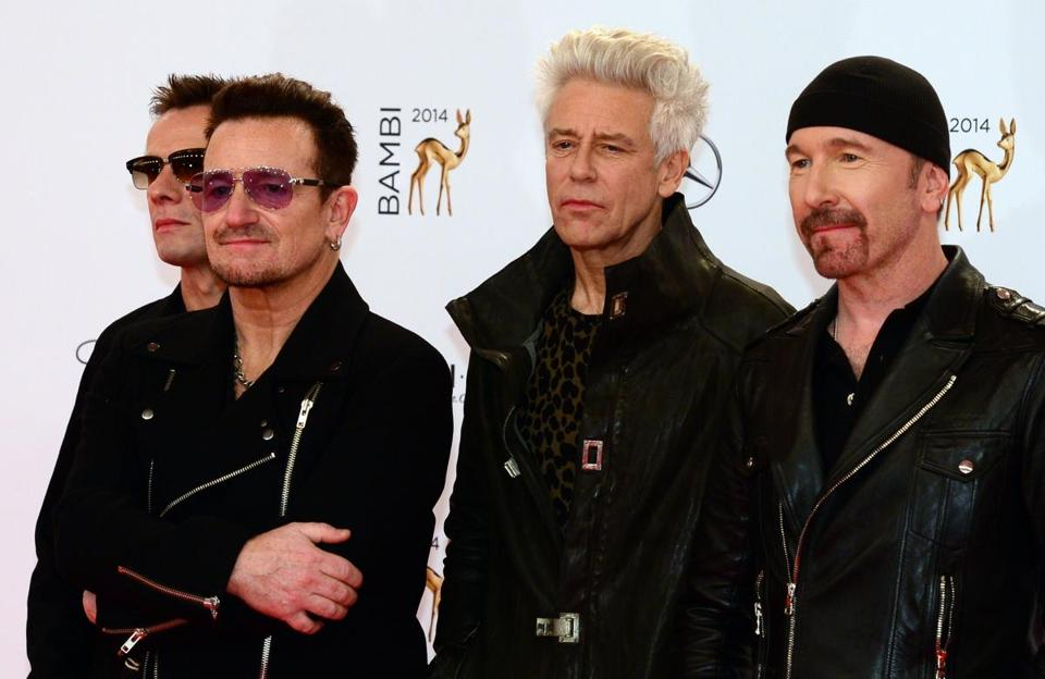 The members of Irish band U2 (from left) Larry Mullan Jr., Bono, Adam Clayton, and The Edge in Berlin on Nov. 13.