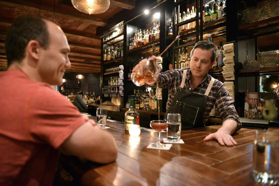 Bartender Sean Frederick Pours A Manhattan Made With 10 Year Old Henry  McKenna Whiskey