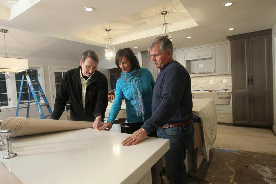"Stars Norm Abram (left) and Tom Silva of ""This Old House"" showed Mindy Pollack-Fusi around in the kitchen while it was under construction."