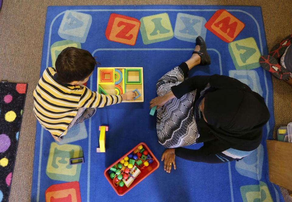 A teacher-in-training and a child played with shape blocks during a Pre-Kindergarten class in Seattle.