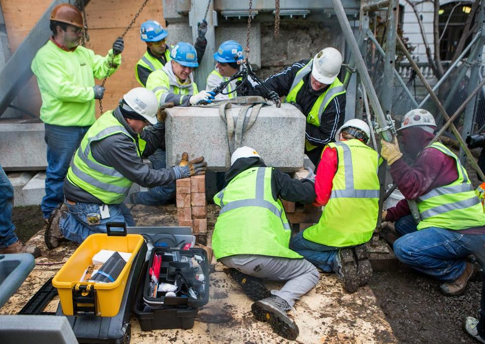 A crew worked on the cornerstone. A time capsule was placed there in 1795, historical records indicate.