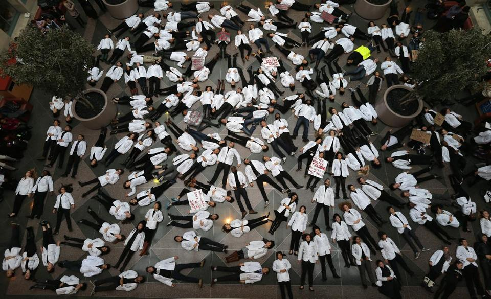 Students, faculty, and staff at Harvard Medical School held a 15½-minute die-in at the school's Boston campus on Wednesday.