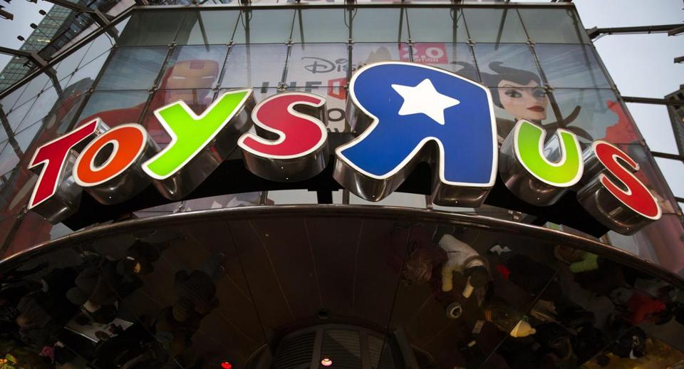 A Toys 'R' Us store logo sign in New York.