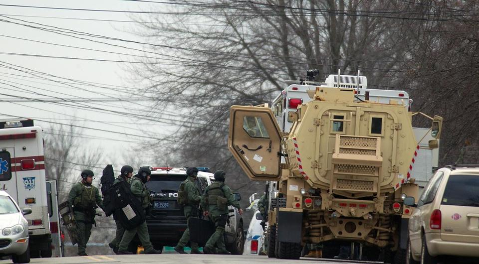 A SWAT team gathers near the scene of a shooting Monday in Souderton, Pa., outside Philadelphia.