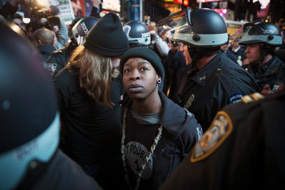 A demonstrator was arrested Nov. 25 in New York during a protest against a grand jury's decision not to indict Ferguson police officer Darren Wilson.